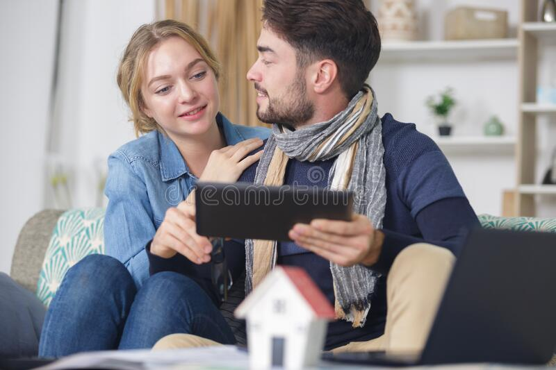 Couple talking about their future home stock photography