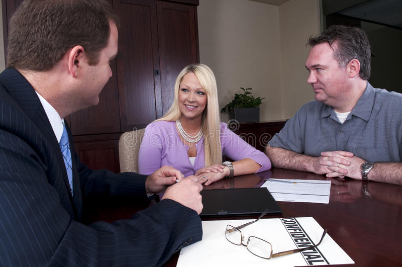 Download Couple talking to advisor stock photo. Image of male - 14367086