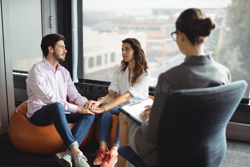Couple talking to a marriage counselor. During therapy royalty free stock photo