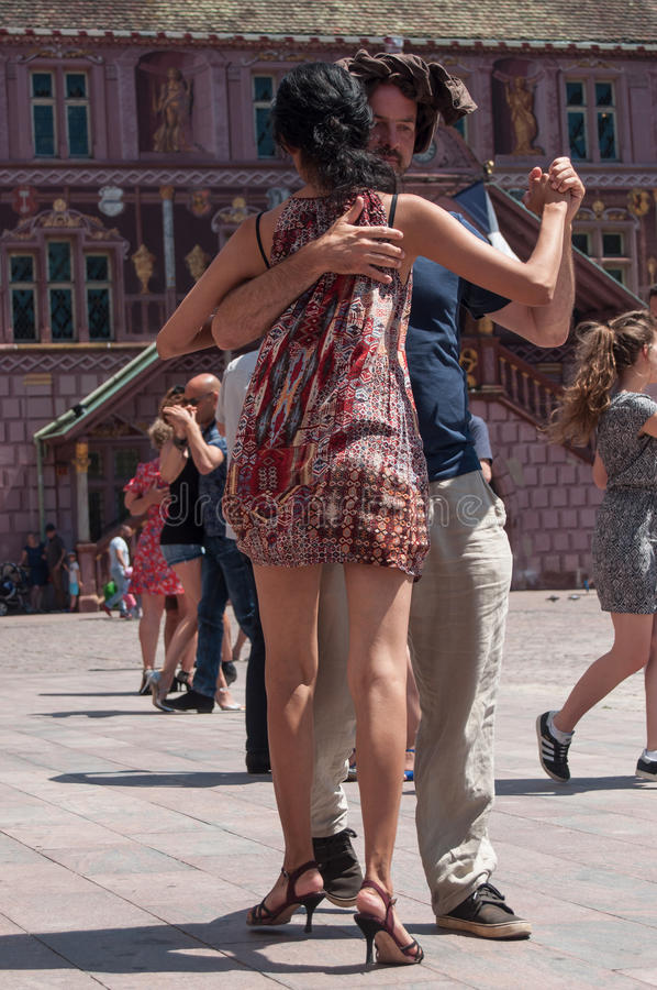 Couple of tango dancers on main place with other dancers at the spring tango festival stock image