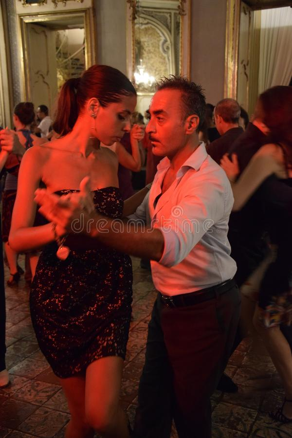 A couple of tango dancers in a milonga in Catania royalty free stock photo