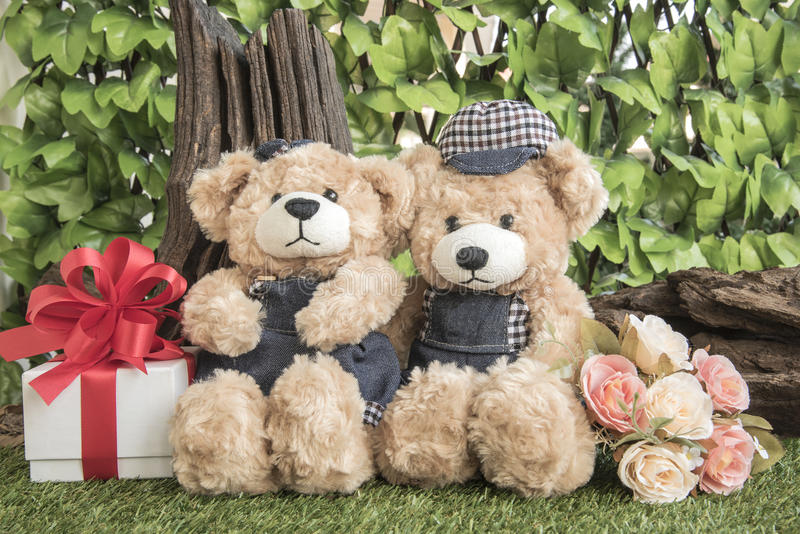 Couple teddy bears with rose and present stock images