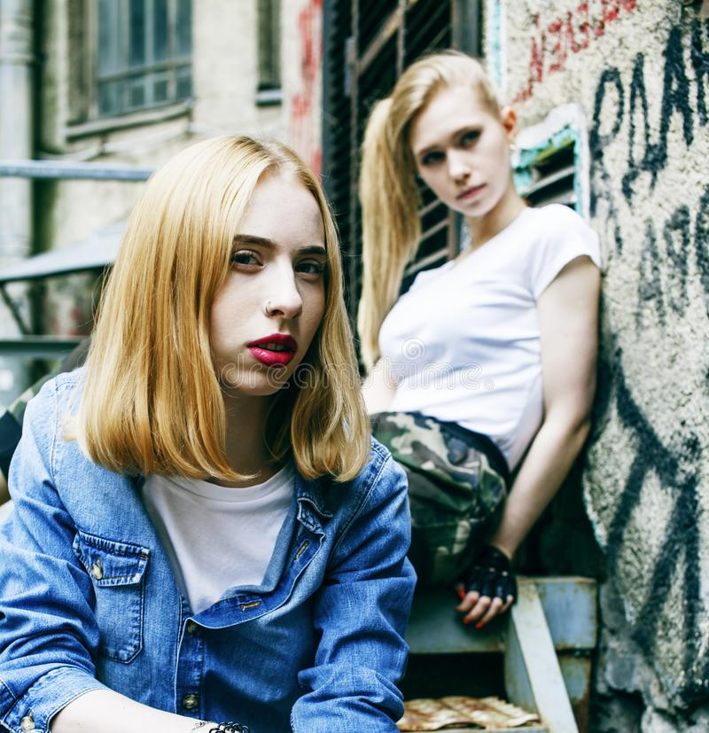 Couple of teenage girls ouyside on streets chilling, lifestyle people concept royalty free stock images