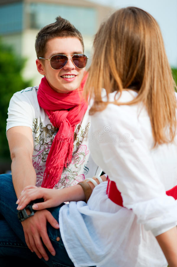 Couple of teenagers is speaking royalty free stock photography