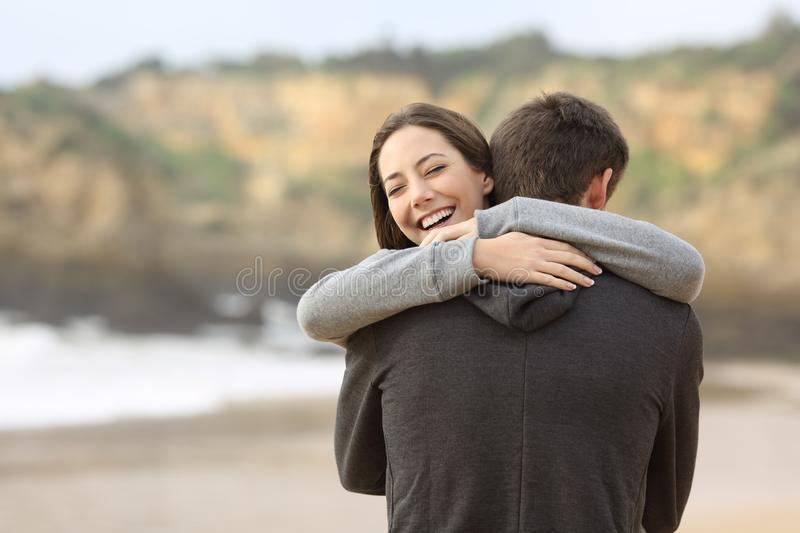 Couple of teens hugging on the beach stock image