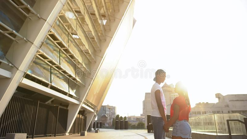 Couple tenderly looking at each other and holding hands, romantic relationship. Stock photo royalty free stock photo
