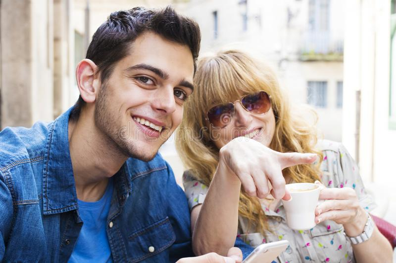 Couple on the terrace. Drinking coffee stock photography