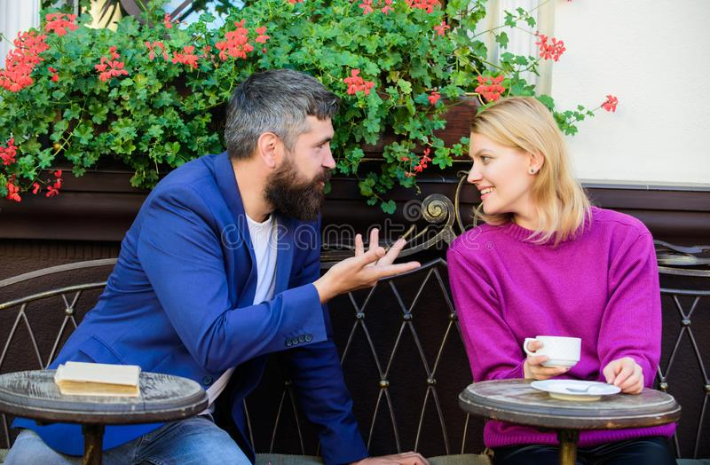 Couple terrace drinking coffee. Casual meet acquaintance public place. Romantic couple. Normal way to meet and connect. With other single people. Meet become royalty free stock photos