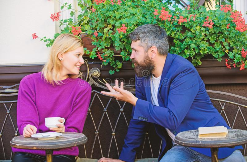 Couple terrace drinking coffee. Casual meet acquaintance public place. Romantic couple. Normal way to meet and connect. With other single people. Meet become stock image