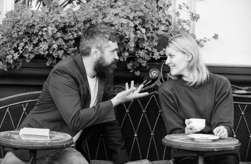 Couple terrace drinking coffee. Casual meet acquaintance public place. Romantic couple. Normal way to meet and connect. With other single people. Meet become stock photography