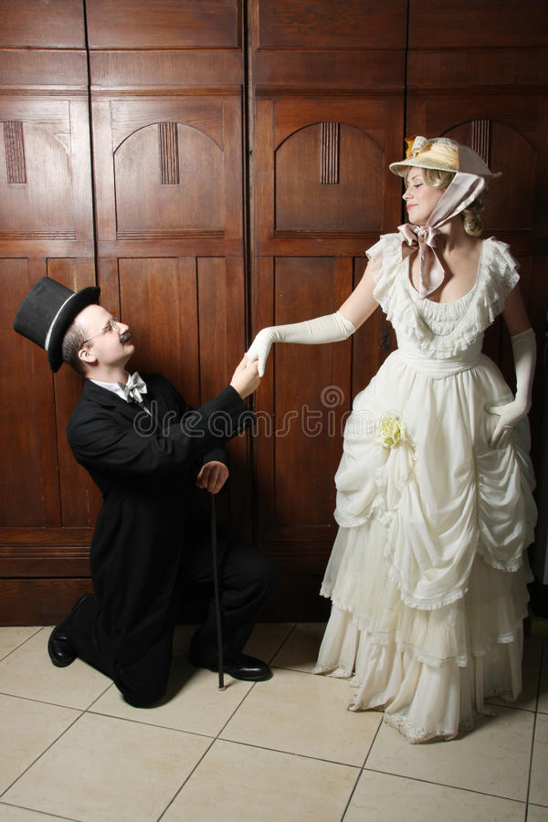 Couple in 19th century garment with woman in dominant role stock images