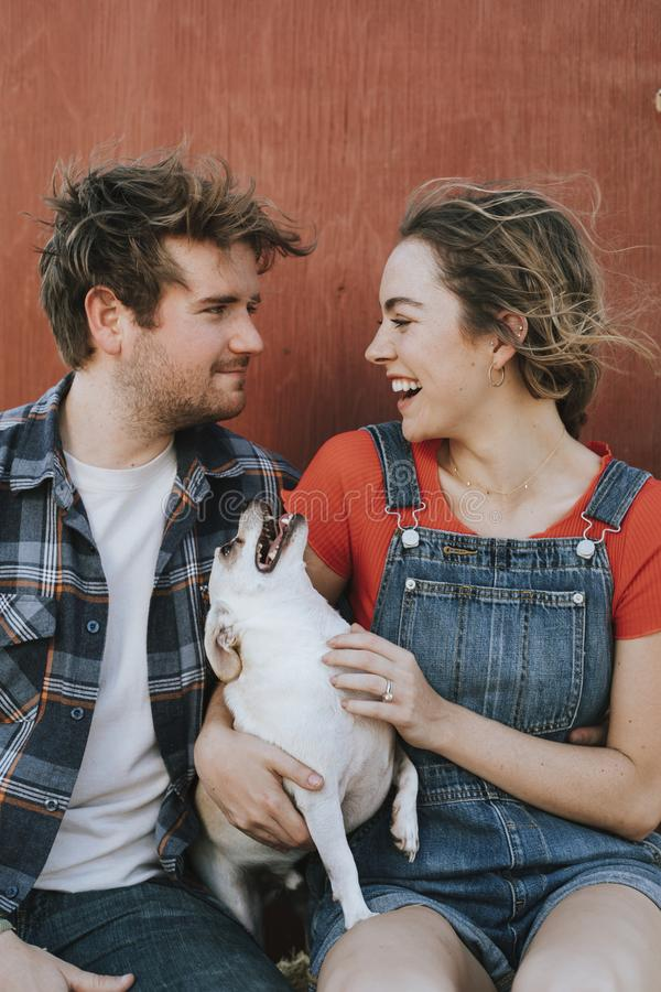 Couple with their adopted Chihuahua dog stock photography