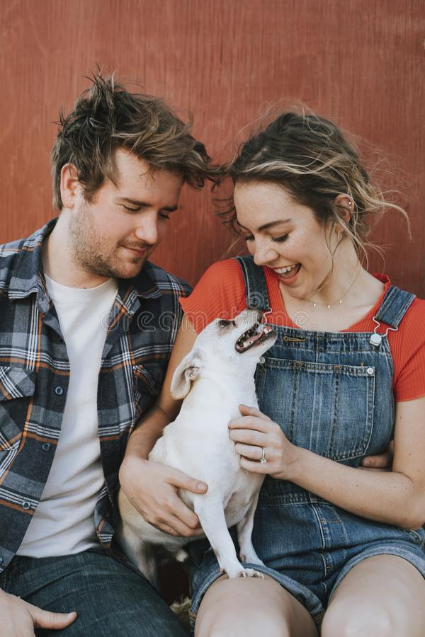 Couple with their adopted Chihuahua dog royalty free stock photo