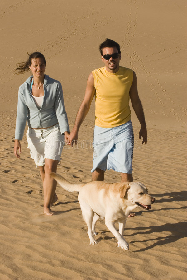 Couple with their dog stock image