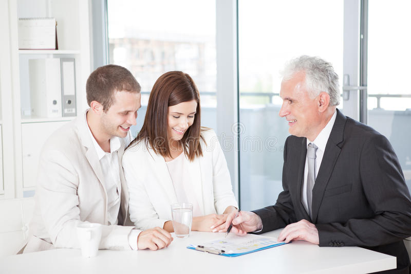 Download Couple With Their Financial Advisor Stock Photo - Image: 34877988