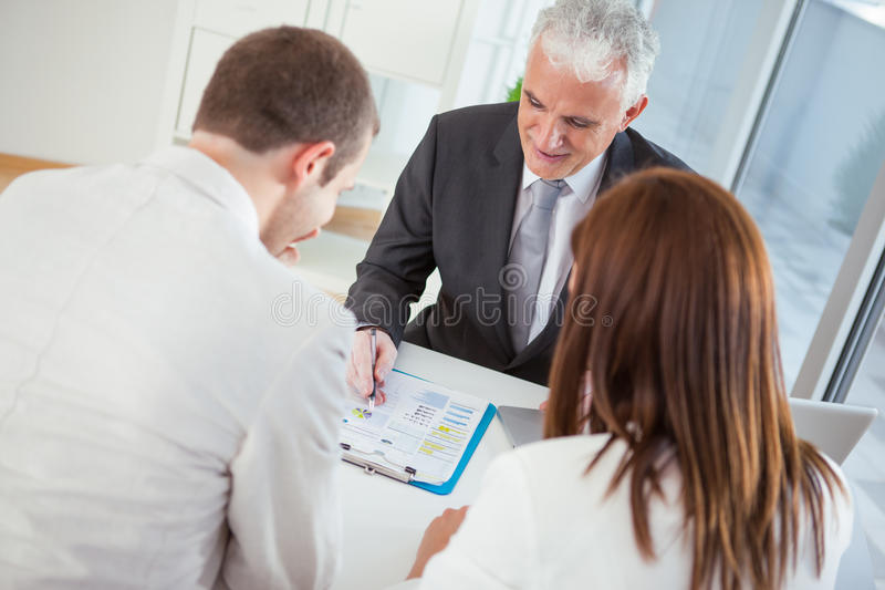 Download Couple With Their Financial Advisor Stock Photo - Image: 34878050