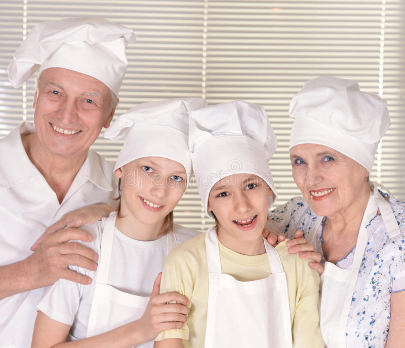 Couple and their grandchildren royalty free stock photos