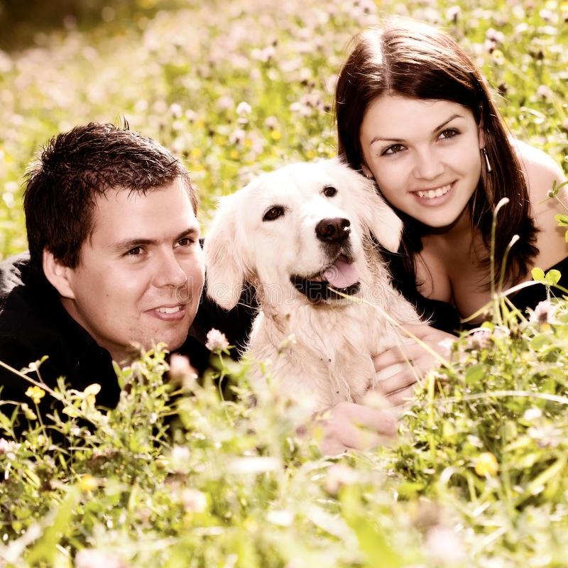 Download Couple With Their Puppy stock image. Image of grass, couple - 23292879