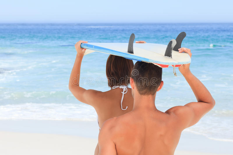 Download Couple With Their Surfboard Stock Image - Image: 18702481