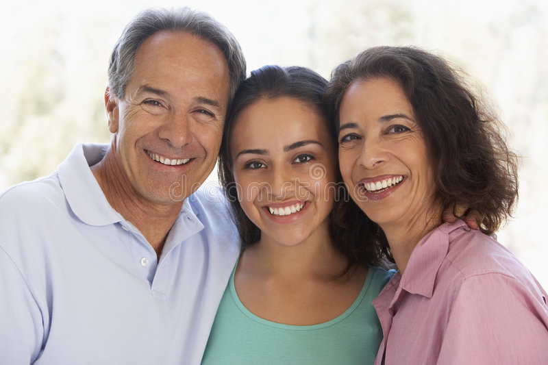Couple With Their Teenage Daughter. Portrait Of Couple With Their Teenage Daughter stock photography