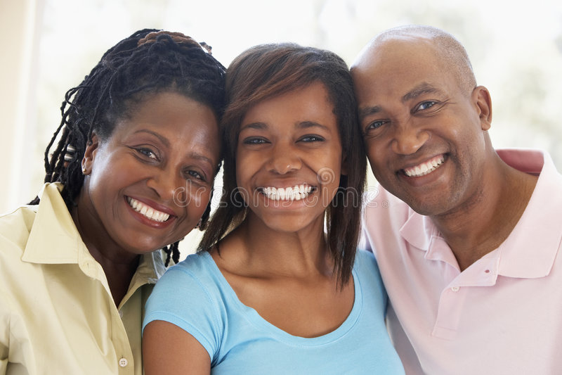 Couple With Their Teenage Daughter. Portrait Of Couple With Their Teenage Daughter royalty free stock photos
