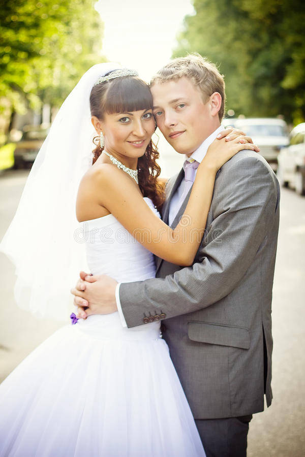 A couple on their wedding day stock images