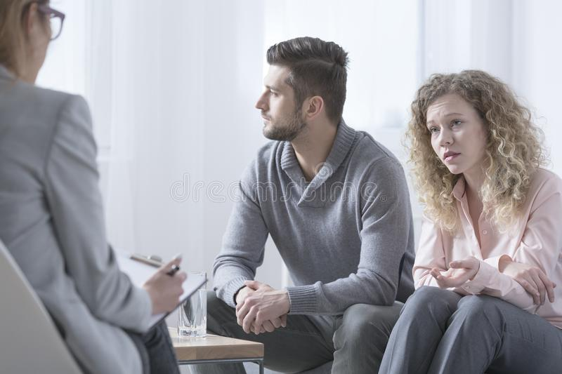 Couple on therapy session. Young married couple talking to psychiatrist on therapy session stock photos