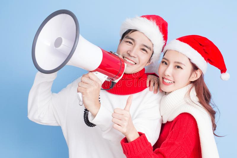 Couple smile with merry christmas. Couple thumb up and take microphone with merry christmas royalty free stock photography