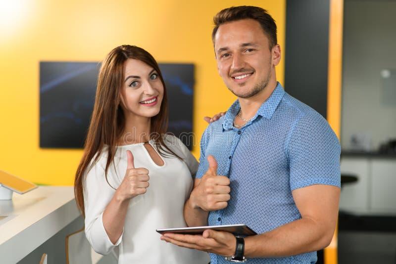 Couple thumbs up stock photo