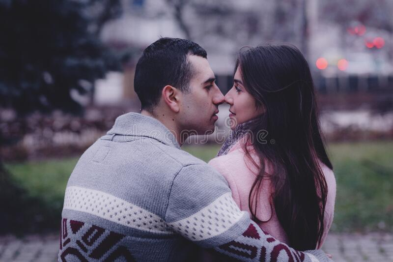 A couple about to kiss royalty free stock image