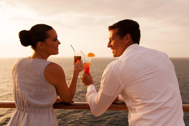 Couple toasting cruise stock photography