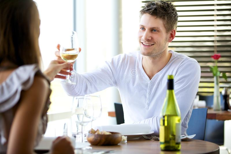 Download Couple Toasting Glasses Of Wine Stock Image - Image: 24892661