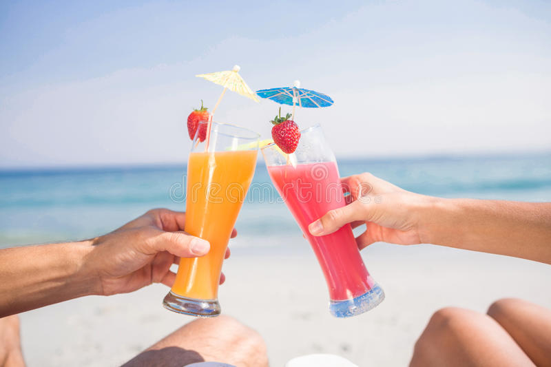 Couple toasting together at the beach stock photos