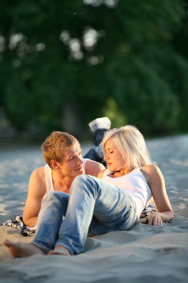 Couple together on sand beach royalty free stock photo