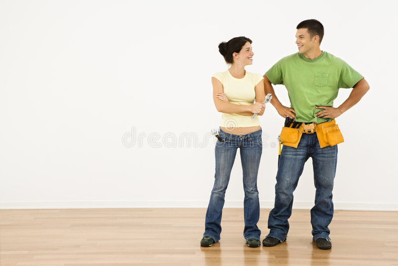 Couple with tools. royalty free stock photos