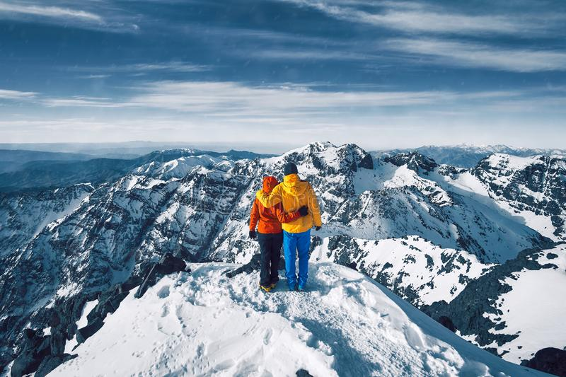 Couple at the top of Jebel Toubkal in Morocco royalty free stock photo