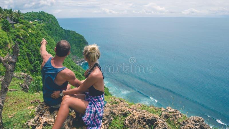 Couple of tourist of Nunggalan Beach near Uluwatu, Bali, Indonesia royalty free stock image