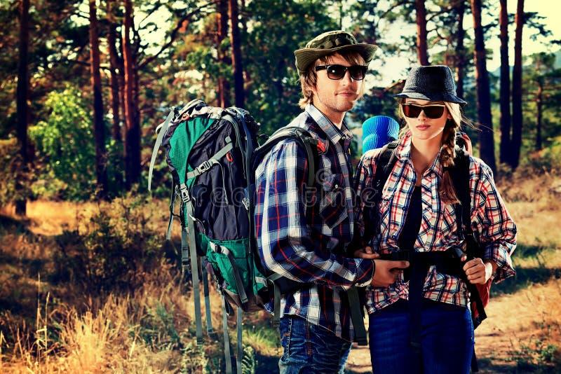 Couple tourists. Couple of tourists on a trekking trail stock photo