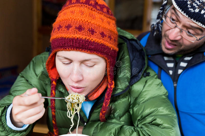 Couple tourists eating spaghetti noodles. royalty free stock photography