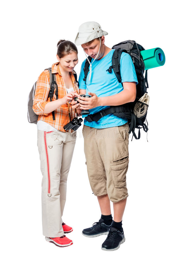 Couple of tourists looking at their photos on a camera royalty free stock photo