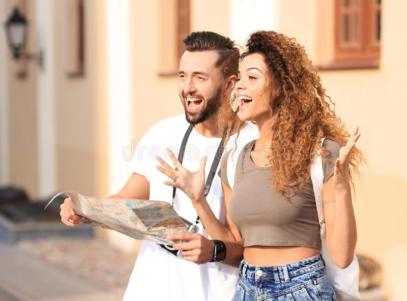 A pair of happy young tourists sightseeing in summer royalty free stock photography