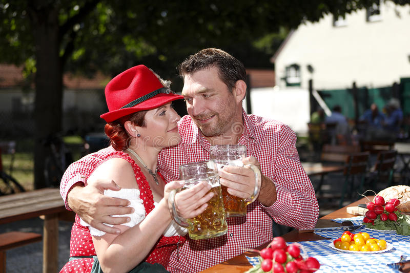 Download Couple In Traditional Costumes In A Bavarian Beer Garden Stock Image - Image of measure  sc 1 st  Dreamstime.com & Couple In Traditional Costumes In A Bavarian Beer Garden Stock Image ...