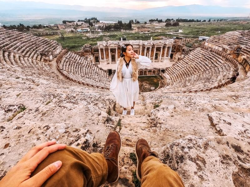 Couple travel at Hierapolis ancient Pamukkale tranvanter pools , Denizli Turkey.  royalty free stock photography