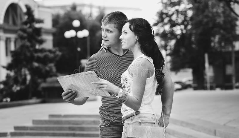 Download Couple Of Travelers Holding A Map Stock Photo - Image of love, lifestyle: 32945280