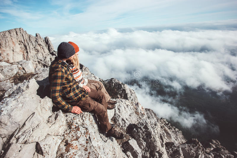 Couple travelers Man and Woman sitting on mountains royalty free stock images