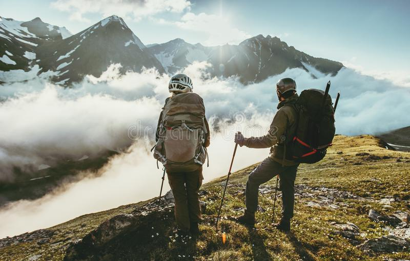 Couple travelers on mountain summit together love and Travel Lifestyle. Wanderlust concept adventure vacations outdoor royalty free stock images