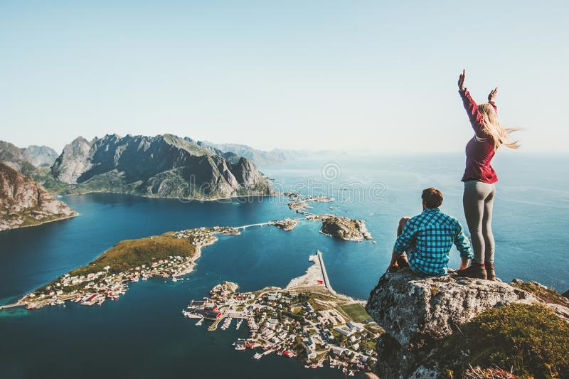 Couple travelers traveling together on top cliff royalty free stock image