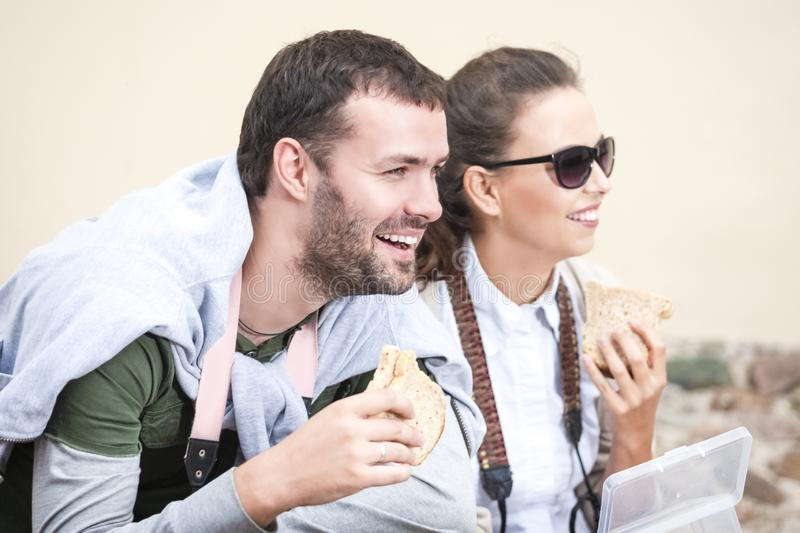 Couple Traveling Around City. Having Lunch with Sandwiches royalty free stock photo