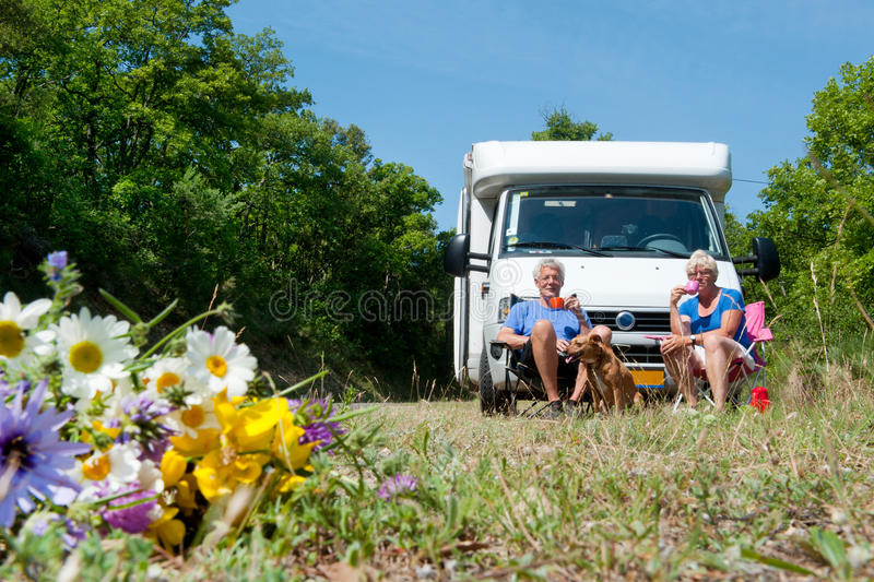 Download Couple Is Traveling By Camping Car Royalty Free Stock Images - Image: 19635749