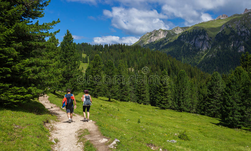 Couple traveling in Dolomite Alps royalty free stock image
